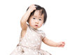 Asia baby girl scratch her hair isolated on white Stock Images