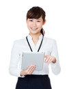 Asia businesswoman using digital tablet Royalty Free Stock Photo