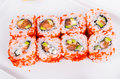 Asia. California rolls with salmon red fish on a white plate o