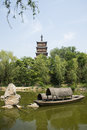 Asia China, Beijing, elm village, park, garden architecture,The wooden pagoda, the lake, the boat Royalty Free Stock Photo