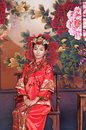 Asia / Chinese girl in red traditional dress Royalty Free Stock Photo