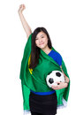 Asia excited woman drape with brazil flag for world cup and football Stock Photos