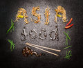 Asia food inscription of noodles and sauce with chopstick and red chili on dark slate background top view Royalty Free Stock Image