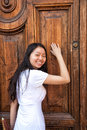 Asia girl knock on door a chinese doorn Royalty Free Stock Photos