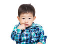 Asia little boy finger suck into mouth isolated on white Stock Photos
