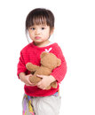 Asia little girl holding with doll Royalty Free Stock Photo