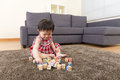 Asia little girl playing toy block at home Stock Images