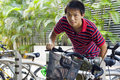 Asia man take bike in bicyle park Royalty Free Stock Image