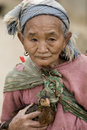 Asia, old woman with chicken Royalty Free Stock Photo