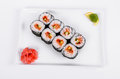 Asia. Rolls with salmon red fish on a white plate on a white b