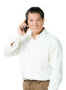 Asia senior man using mobile isolated Royalty Free Stock Photos