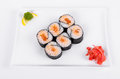 Asia. Spicy rolls with salmon red fish on a white plate on a w
