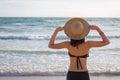 Asia woman with hat and bikini on sea beach Royalty Free Stock Photo