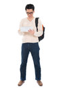 Asian adult student using tablet pc full body in casual wear with school bag digital computer standing isolated on white Royalty Free Stock Image