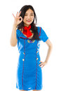 Asian air stewardess showing ok sign isolated on white background