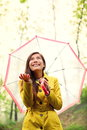 Asian autumn woman happy after rain under umbrella walking with female model looking up at clearing sky joyful on rainy fall day Stock Photography