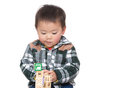 Asian baby boy concentrate on playing toy block isolated white Royalty Free Stock Image