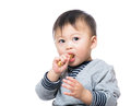 Asian baby boy eating biscuit isolated on white Royalty Free Stock Image