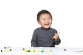 Asian baby boy enjoy drawing Stock Image