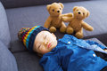Asian baby boy sleeping with doll Royalty Free Stock Photo