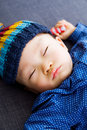 Asian baby boy sleeping lay down on sofa Royalty Free Stock Photography