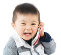 Asian baby boy talk to mobile isolated on white Royalty Free Stock Image