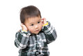 Asian baby boy touch his ear Stock Images