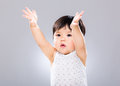 Asian baby boy with two hand raised up on grey color background Royalty Free Stock Images