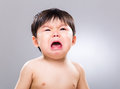 Asian baby cry with gray background Royalty Free Stock Photography