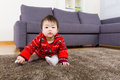 Asian baby girl creeping on carpet the Stock Images