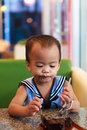 Asian baby girl eating chocolate and mouth is dirty Royalty Free Stock Photo