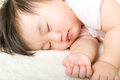 Asian baby girl fall asleep little sleeping Stock Photo