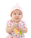 Asian baby girl gripping a toy Royalty Free Stock Photography