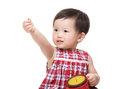 Asian baby girl holding snack box and hand up Stock Photography