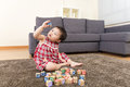Asian baby girl playing toy block at home Stock Photo