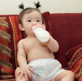 Asian baby girl portrait of drinking milk from bottle Stock Images