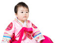 Asian baby girl wear traditional korean hanbok isolated on white Stock Photography