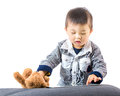 Asian baby touch the tablet digital Royalty Free Stock Photo