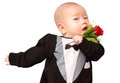 Asian baby in tuxedo a wearing a costume holding a rose Stock Photography