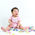 Asian baby with wooden alphabets Royalty Free Stock Photo