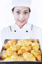 Asian baker brings croissant isolated white Stock Images