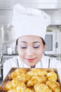 Asian baker smells croissants kitchen Stock Photo