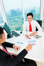 Asian banker counseling financial investment offering client finance assets in bank office Royalty Free Stock Photography