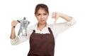 Asian barista girl thumbs down with coffee Moka pot Royalty Free Stock Photo