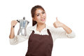 Asian barista girl thumbs up with coffee Moka pot Royalty Free Stock Photo