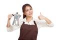 Asian barista girl thumbs up with coffee Moka pot Royalty Free Stock Photo