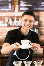 Asian barista offering cup of drip brew coffee in shop Stock Photography