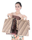 Asian beautiful woman holding shopping bags isolated on white background Royalty Free Stock Photos