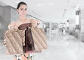 Asian beautiful woman holding shopping bags at the mall Royalty Free Stock Photography