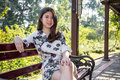 Asian beautiful young woman sitting on bench in outdoor garden Royalty Free Stock Photo